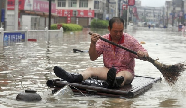 A man searches for his pants after storms hit Asia